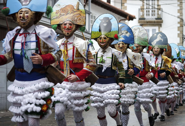 """The 'Peliqueiros' or hairdressers take part in the """"Entroido"""" carnival festival in Laza, near Ourense, northwestern Spain, on March 2, 2014. (Photo by Pedro Armestre/AFP Photo)"""