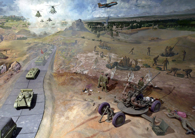 A scene of Afghanistan's war against the former Soviet Union's army is portrayed in a diorama in the People's Museum, or Manzar-e Jahad, in Herat, on April 11, 2010. (Photo by Mohammad Shoib/Reuters)