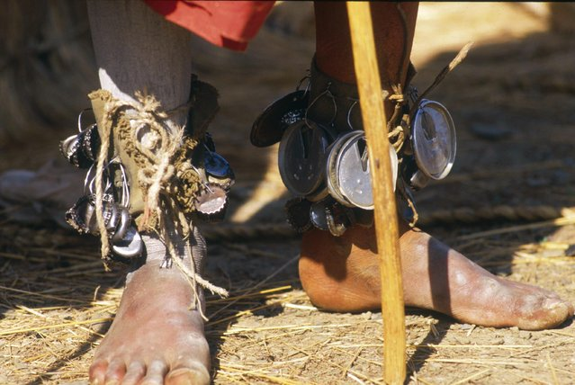 Pictured here are the feet of a Sangoma, adorned with little bells. In a surprising mix of tradition and modernism, they are actually made of soda cans tops and bottle caps. (Photo by Patrick Durand/Sygma via Getty Images)