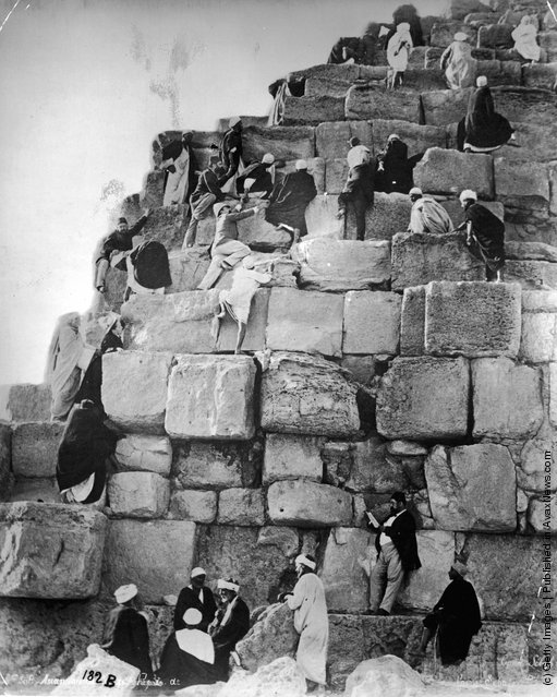 Egyptians clambering up the rock slabs of a pyramid, 1880