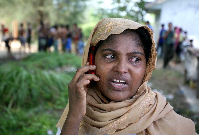 An ethnic Rohingya woman cries as she uses her phone to call a relative back home, at a temporary shelter in Langsa, Aceh province, Indonesia, Saturday, May 16, 2015. (Photo by Binsar Bakkara/AP Photo)