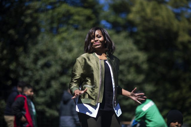 US First Lady Michelle Obama welcomes students from across the country to help plant the White House Kitchen Garden on the South Lawn of the White House in Washington DC, USA, 05 April 2016. Michelle Obama has planted a vegetable garden on the South Lawn every year since 2009. (Photo by Jim Lo Scalzo/EPA)