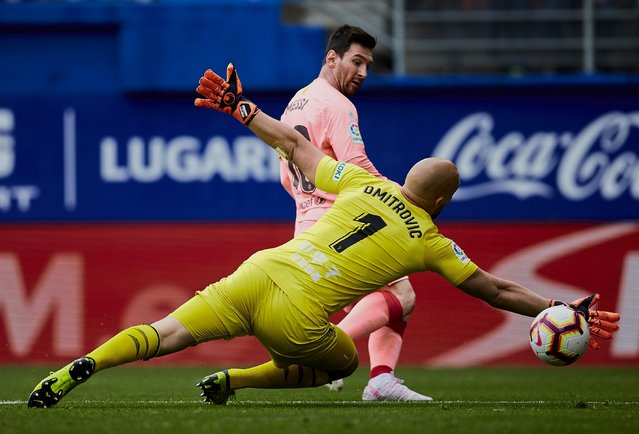 Barcelona's Lionel Messi shoots to score in front Eibar's goalkeeper Marko Dmitrovic during a Spanish La Liga soccer match at the Ipurua stadium, in Eibar, northern Spain, Sunday, May 19, 2019. (Photo by Ion Alcoba/AP Photo)