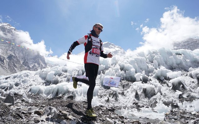 In this handout photograph released by the Tenzing-Hillary Everest Marathon on May 29, 2019 a runner competes in the world's highest marathon in the foothills of Mount Everest in the Solukhumbu district of Nepal. - More than 224 including 160 foreigners from 30 countries and local runners took part in the world's highest marathon to mark the anniversary of the first summit of the peak by Tenzing Norgay and Edmund Hillary on May 29, 1953. (Photo by Handout/Tenzing-Hillary Everest Marathon/AFP Photo)