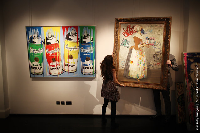 Chocolate Vandal (R) and 'Tomato Spray are hung at the Opera Gallery
