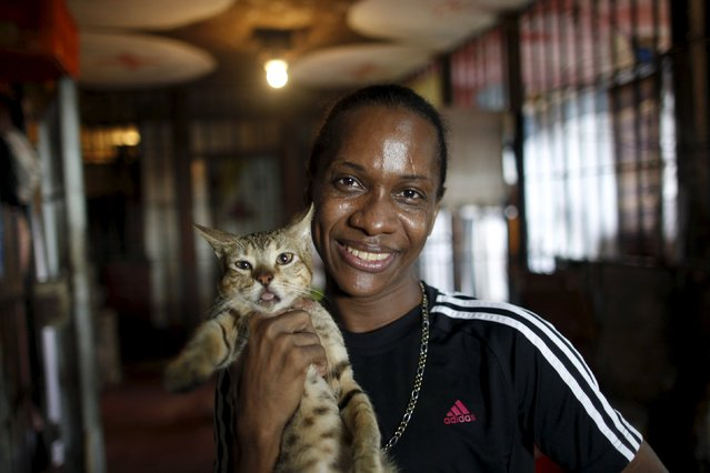 Inmate Miguel Anguel Quiros poses for a photograph with his cat at the transgender gallery in La Joya prison on the outskirts of Panama City, Panama November 12, 2015. (Photo by Carlos Jasso/Reuters)