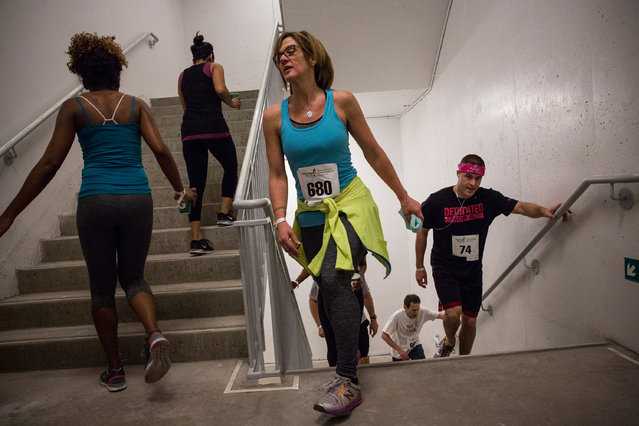 """People run in the """"Runyon Up"""" a stair race in which participants run up 72 floors of stairs inside the Four World Trade Center building on April 3, 2014 in New York City. The race attracted hundreds of participants, with the winner finishing in under 10 minutes. The run raised money and awareness for cancer research.  (Photo by Andrew Burton/Getty Images)"""