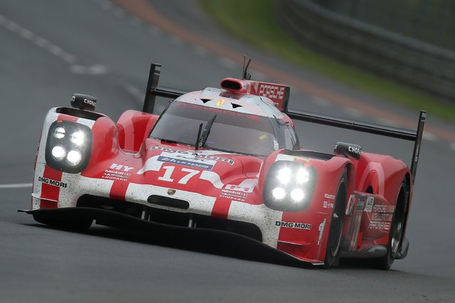 The Porsche 919 Hybrid No17 of the Porsche Team driven by Timo Bernhard of Germany, Marck Webber of Australia and Brendon Hartley of New Zealand is seen in action during the 83rd 24-hour Le Mans endurance race, in Le Mans, western France, Saturday, June 13, 2015. (AP Photo/David Vincent)