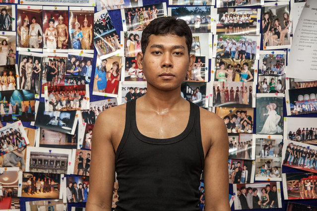 A male Sun Model student poses in front of a wall of photographs from the agency's previous shows during training at the fashion school on March 31, 2014 in Phnom Penh, Cambodia. (Photo by Omar Havana/Getty Images)