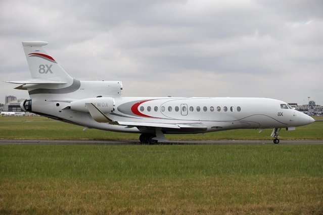 A new Falcon 8X aircraft warms up prior to a demonstration flight at the Paris Air Show, in Le Bourget airport, north of Paris, Thursday, June 18, 2015. Some 300,000 aviation professionals and spectators are expected at this week's Paris Air Show, coming from around the world to make business deals and see dramatic displays of aeronautic prowess and the latest air and space technology. (AP Photo/Francois Mori)