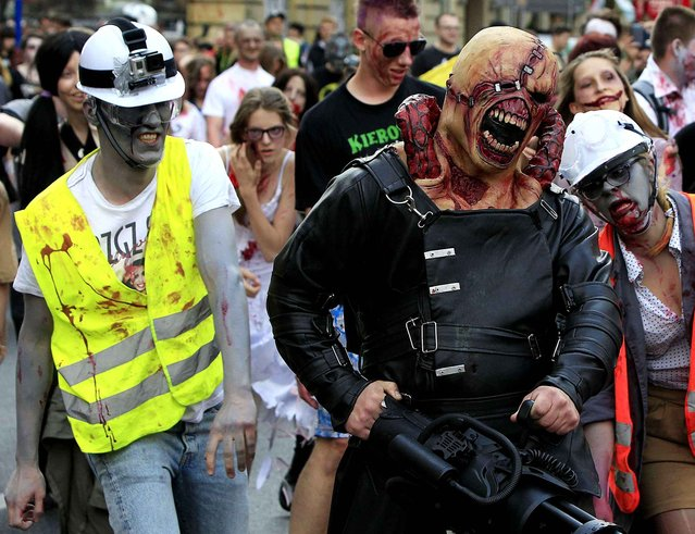 Young people dressed as zombies gather to take part in a Zombie Walk on streets of Warsaw, Poland, Saturday, June 27, 2015. (Photo by Czarek Sokolowski/AP Photo)