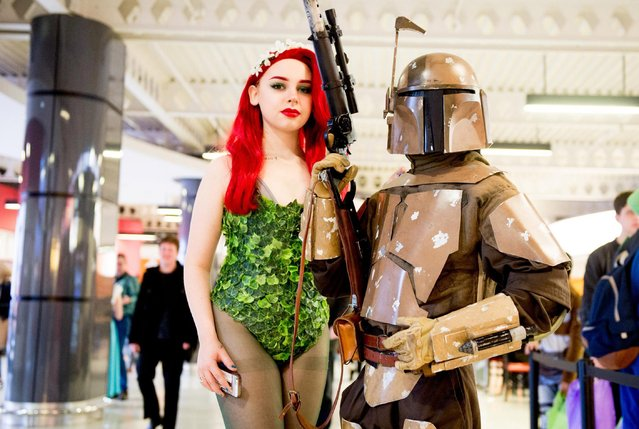 A Poison Ivy and Boba Fet (Star Wars) cosplayer during the MCM Birmingham Comic Con at NEC Arena on March 18, 2017 in Birmingham, England. (Photo by Ollie Millington/Getty Images)