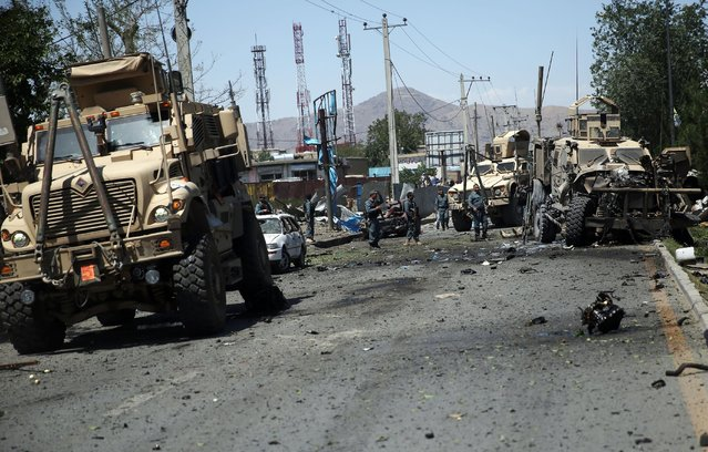 Afghanistan security personnel work at the site of a suicide attack in Kabul, Afghanistan, Tuesday, June 30, 2015. (Photo by Massoud Hossaini/AP Photo)
