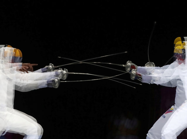 Venezuela's Ruben Limardo competes against his brother Jesus Limardo during the Fencing Men's Epee Individual Gold Medal Bout at the Lima 2019 Pan-American Games in Lima, Peru on August 5, 2019. (Photo by Guadalupe Pardo/Reuters)