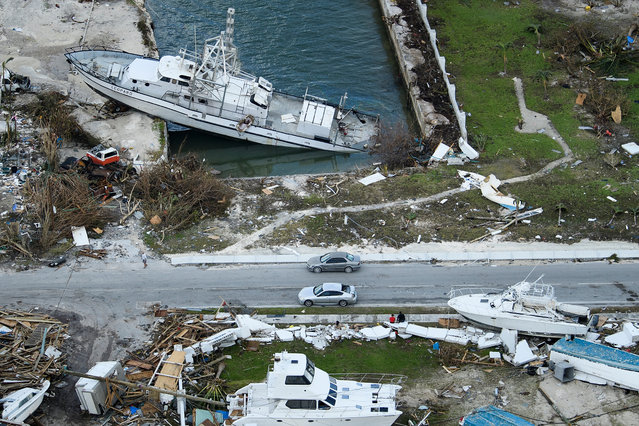 An aerial view of damage from Hurricane Dorian on September 5, 2019, in Marsh Harbour, Great Abaco Island in the Bahamas. Hurricane Dorian lashed the Carolinas with driving rain and fierce winds as it neared the US east coast Thursday after devastating the Bahamas and killing at least 20 people. (Photo by Brendan Smialowski/AFP Photo)