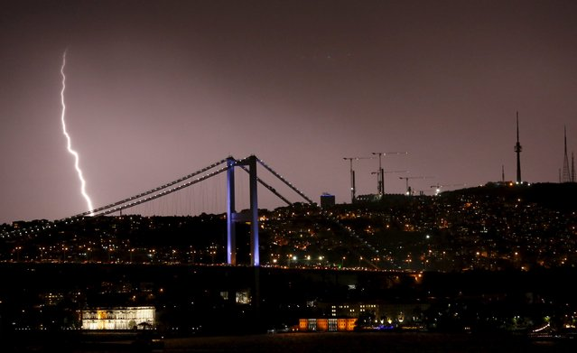 Lightning strikes over the Bosphorus bridge during heavy rainfall in Istanbul, Turkey, May, 7 2015. (Photo by Murad Sezer/Reuters)