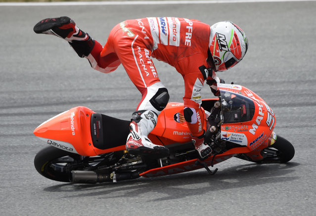Spain's Juanfran Guevara crashes during the Moto3 qualifying at the Sachsenring circuit in Hohenstein-Ernstthal, Germany, Saturday, July 11, 2015. (Photo by Jens Meyer/AP Photo)