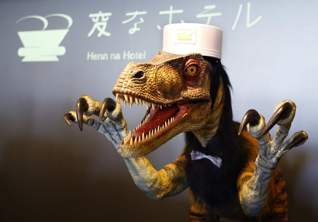 "A receptionist dinosaur robot performs at the new robot hotel, aptly called Henn na Hotel or Weird Hotel, in Sasebo, southwestern Japan, Wednesday, July 15, 2015. From the receptionist that does the check-in and check-out to the porter that's a stand-on-wheels taking luggage up to the room, the hotel, that is run as part of Huis Ten Bosch amusement park, is ""manned"" almost totally by robots to save labor costs. (Photo by Shizuo Kambayashi/AP Photo)"