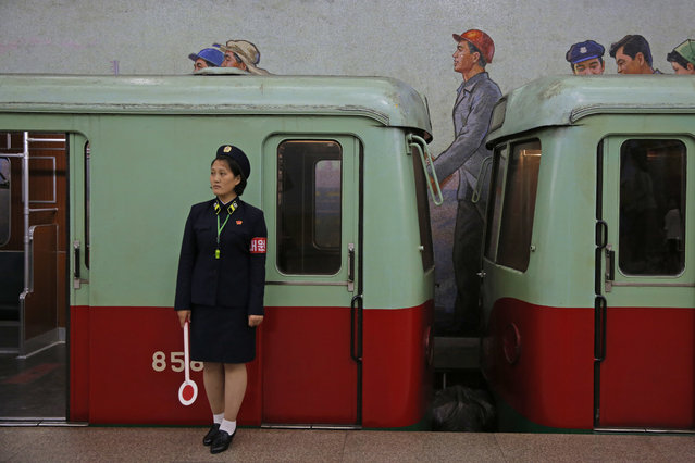 In this September 13, 2018, file photo, a North Korean subway officer stands next to a train in a subway station in Pyongyang, North Korea. At the negotiating table, it can be difficult to get the North Koreans off their scripted talking points. (Photo by Kin Cheung/AP Photo)