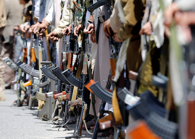 Tribesmen loyal to the Houthi hold their rifles during a gathering to show support to the movement in Sanaa, Yemen, May 19, 2016. (Photo by Khaled Abdullah/Reuters)