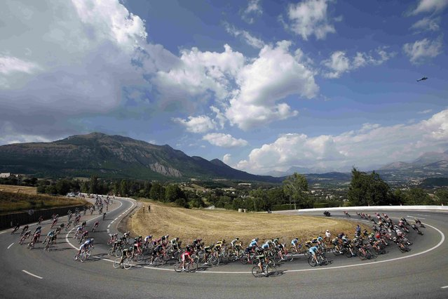 The pack of the riders speed along Cabre pass during the 201-km (124 miles) 16th stage of the 102nd Tour de France cycling race from Bourg-de-Peage to Gap, France, July 20, 2015. (Photo by Eric Gaillard/Reuters)