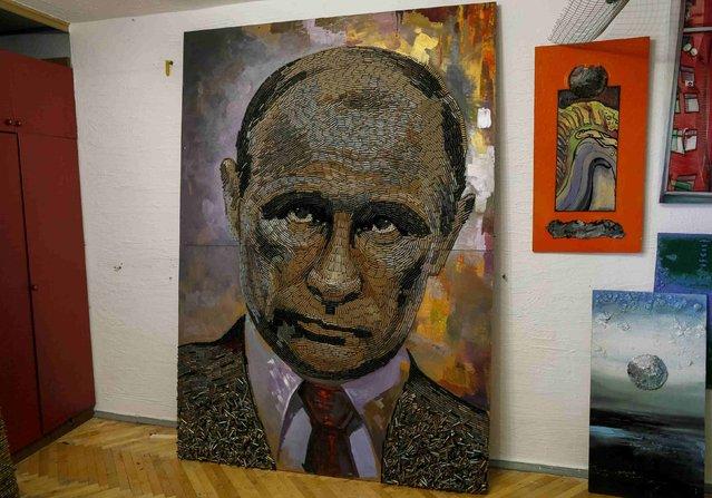 "A portrait of Russian President Vladimir Putin, made out of 5,000 cartridges brought from the frontline in eastern Ukraine, named ""The Face of War"" is seen in the studio of Ukrainian artist Dariya Marchenko, in Kiev, July 23, 2015. (Photo by Gleb Garanich/Reuters)"