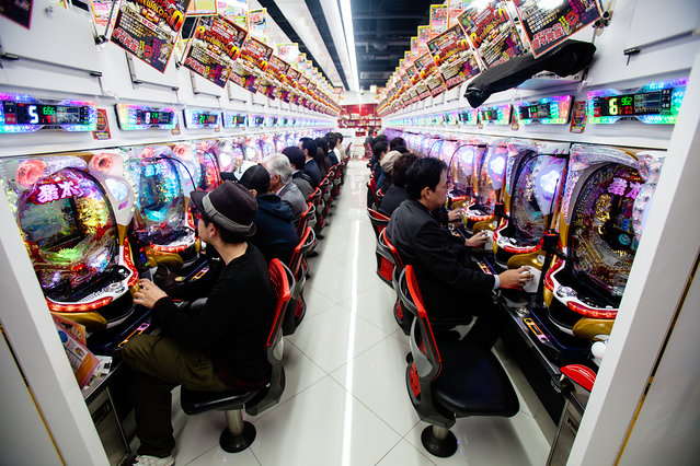 """""""Pachinko Culture"""". Inside a pachinko parlour, everyone is just concentrating on the machine in front of them. Photo location: Tokyo, Japan. (Photo and caption by Swee Ong Wu/National Geographic Photo Contest)"""