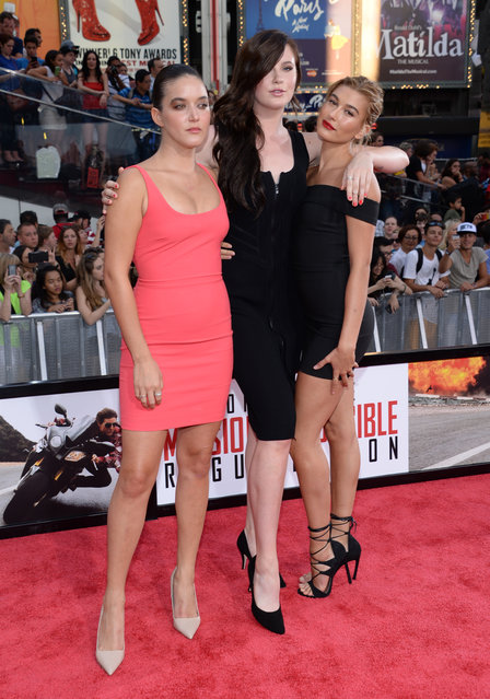 """Alaia Baldwin, from left, Ireland Baldwin and Hailey Baldwin attend the premiere of """"Mission: Impossible – Rogue Nation"""" in Times Square on Monday, July 27, 2015, in New York. (Photo by Evan Agostini/Invision/AP Photo)"""