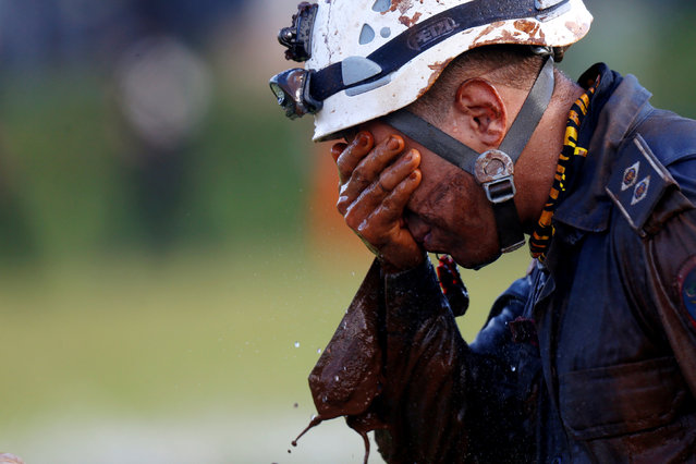 A member of rescue team reacts, upon returning from the mission, after a tailings dam owned by Brazilian mining company Vale SA collapsed, in Brumadinho, Brazil on January 27, 2019. (Photo by Adriano Machado/Reuters)