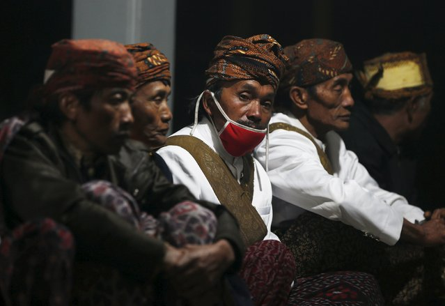 Tenggerese shamans sit during the Kasada Festival at Mount Bromo in Probolinggo, Indonesia's East Java province, August 1, 2015. (Photo by Reuters/Beawiharta)