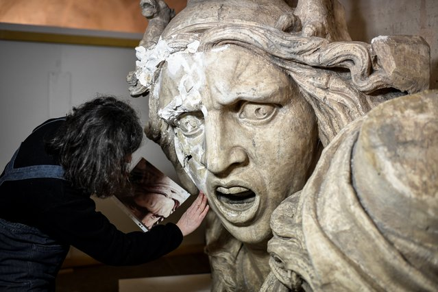 A mould of 'the Genie de la Patrie' damaged during a yellow vest protests at the Arc de Triomphe last December is seen during its renovation by French restorer Agnes Le Boudec, on March 25, 2019 in Paris. (Photo by Stephane De Sakutin/AFP Photo)