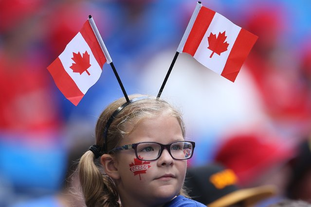 A young fan of the Toronto Blue Jays celebrates Canada Day before the start of MLB game action against the Milwaukee Brewers on July 1, 2014 at Rogers Centre in Toronto, Ontario, Canada. (Photo by Tom Szczerbowski/Getty Images)