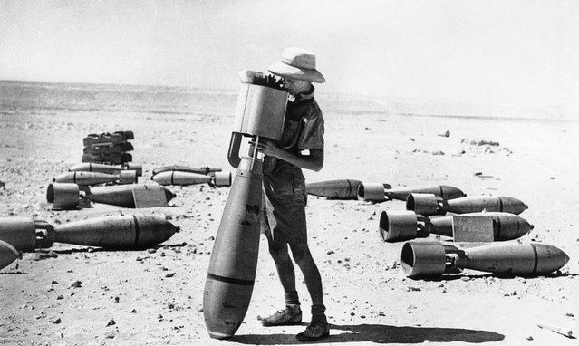 This armorer of the R.A.F.'s middle east command prepares a bomb for its mission against the Italian forces campaigning in Africa. This big bomb is not yet fused, but when it is it will be ready for its deadly work. Photo taken on October 24, 1940