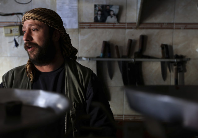 A man works in his kebab shop in Ain Terma neighborhood, Damascus January 23, 2013. (Photo by Goran Tomasevic/Reuters)