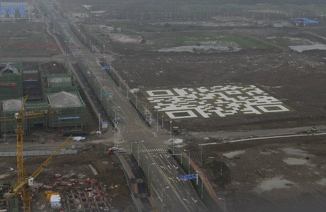 A giant QR code is seen at a residential construction site owned by Chinese developer Vanke in Hefei, Anhui province in this May 17, 2013 file photo. China Vanke is expected to announce H1 results this week. (Photo by Reuters/Stringer)
