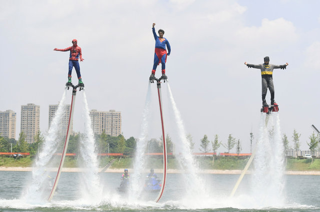 Men dressed as superheroes perform in a stunt show in Tongsheng Lake in Changsha, China July 14, 2017. (Photo by Yang Huafeng/Reuters/CNS)