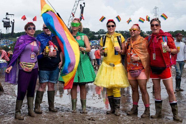 Festival goers cope with muddy conditions on day 2 of the Glastonbury Festival at Worthy Farm, Pilton on June 25, 2016 in Glastonbury, England. Now in its 46th year the festival is one largest music festivals in the world and this year features headline acts Muse, Adele and Coldplay. The Festival, which Michael Eavis started in 1970 when several hundred hippies paid just £1, now attracts more than 175,000 people. (Photo by Ian Gavan/Getty Images)