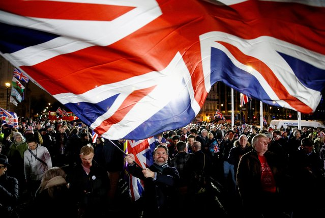 A man waves a British flag on Brexit day in London, Britain January 31, 2020. The United Kingdom leaves the European Union, its most significant change of course since the loss of its empire – and a major blow to 70 years of efforts to forge European unity from the ruins of two world wars. (Photo by Henry Nicholls/Reuters)
