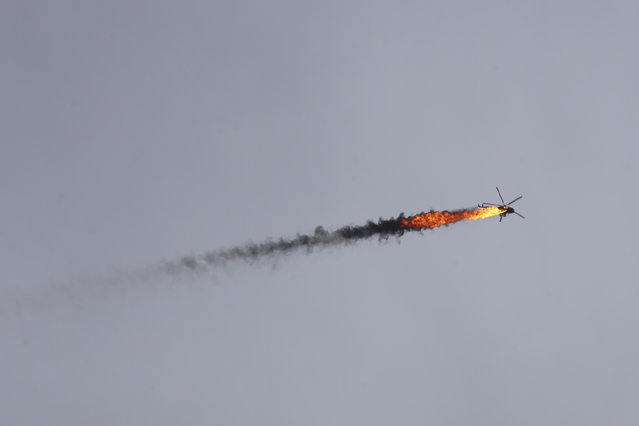 Syrian government helicopter is shot by a missile in Idlib province, Syria, Tuesday, February 11, 2020. Syrian rebels shot down a government helicopter Tuesday in the country's northwest where Syrian troops are on the offensive in the last rebel stronghold. (Photo by Ghaith Alsayed/AP Photo)