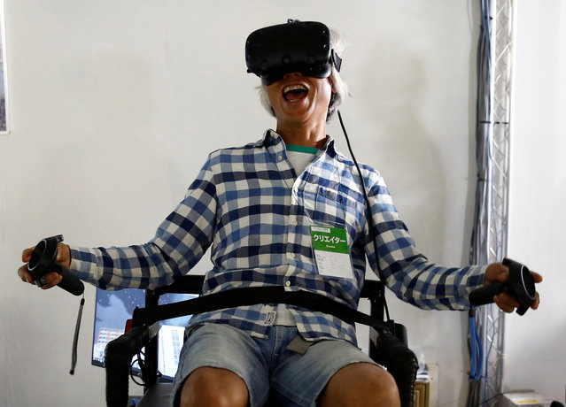 A man tries a Virtual Reality content at VR/AR World during Content Tokyo expo in Tokyo, Japan, June 28, 2017. (Photo by Kim Kyung-Hoon/Reuters)