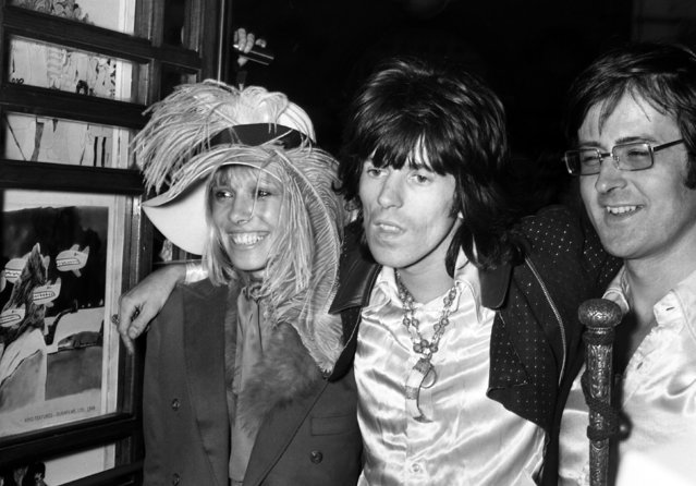 Keith Richards from the Rolling Stones arrives at the premiere of the new Beatles cartoon film Yellow Submarine with Anita Pallenberg at the London Pavillion Cinema, England on July 17, 1968. (Photo by Peter Kemp/AP Photo)