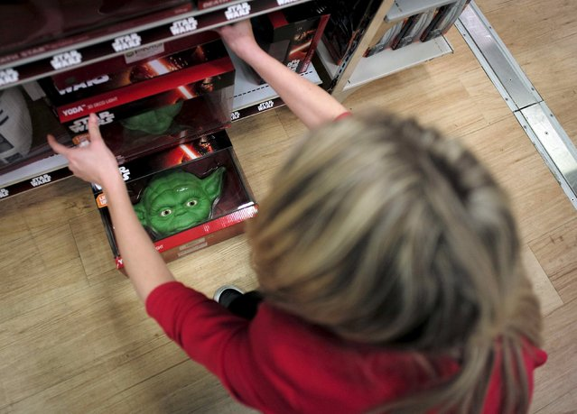 """A department store shelf is stocked with Yoda decorator lights from the upcoming film """"Star Wars: The Force Awakens"""" just before midnight on """"Force Friday"""", September 4, 2015. (Photo by Jason Reed/Reuters)"""