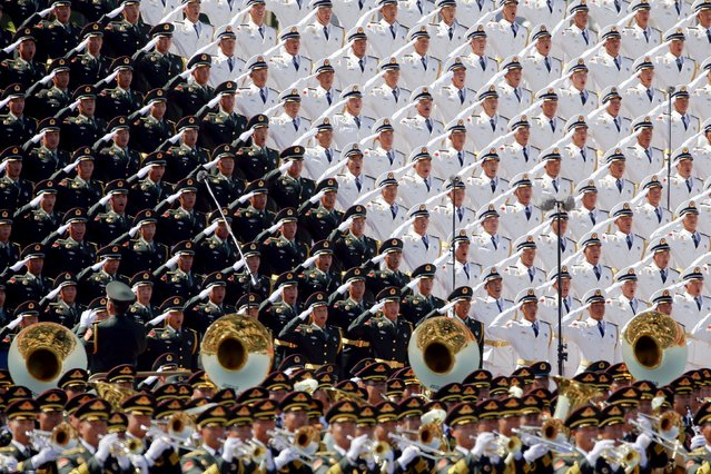 Military band sing and salute at the Tiananmen Square at the beginning of the military parade marking the 70th anniversary of the end of World War Two, in Beijing, China, September 3, 2015. (Photo by Damir Sagolj/Reuters)