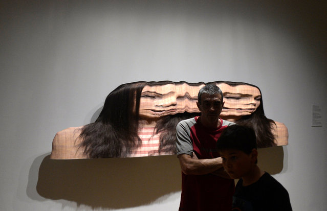 """Visitors stand in front of the sculpture """"Panagiota: Conversation 1, Variation 2"""" by South African artist Evan Penny, at the Hyperrealist Sculpture 1973-2016 exhibition in the Museum of Bellas Artes in Bilbao, northern Spain, July 27, 2016. (Photo by Vincent West/Reuters)"""