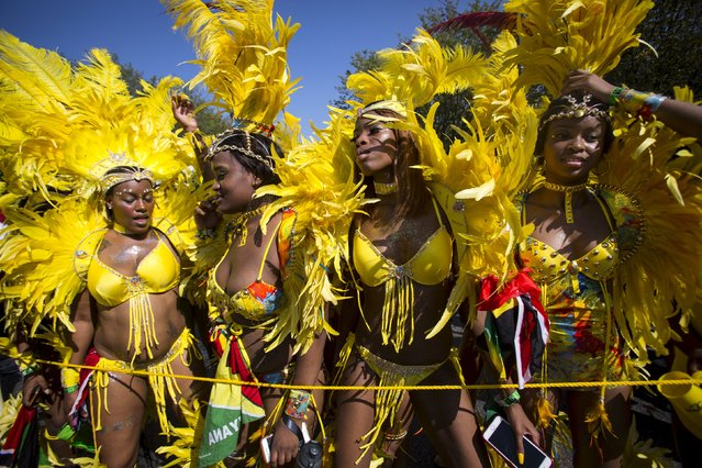 Women dance in costume during the West Indian Day Parade in Brooklyn, New York September 7, 2015. (Photo by Andrew Kelly/Reuters)