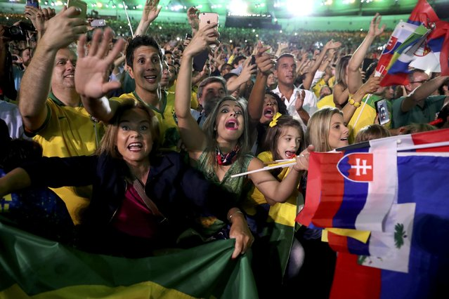 2016 Rio Olympics, Opening ceremony, Maracana, Rio de Janeiro, Brazil on August 5, 2016. Fans from Brazil celebrate in the stands during the opening ceremony. (Photo by Damir Sagolj/Reuters)