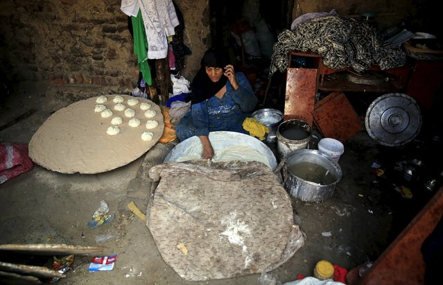 A woman makes bread to sell in the Eshash el-Sudan slum in the Dokki neighbourhood of Giza, south of Cairo, Egypt September 2, 2015. (Photo by Amr Abdallah Dalsh/Reuters)
