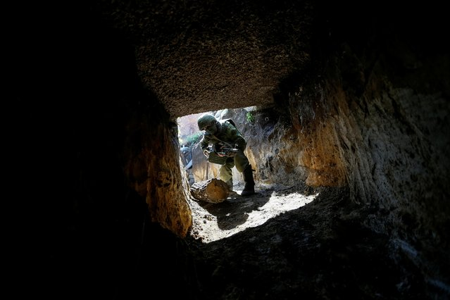 A militant of the separatist Donetsk People's Republic is seen on a position located on the troops contact line with Ukrainian forces in Donetsk Region, Ukraine on May 11, 2020. (Photo by Alexander Ermochenko/Reuters)