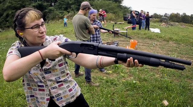 In this October 8, 2017, photo, Zora Gussow aims a shotgun during a training session for the Trigger Warning Queer & Trans Gun Club in a field in Victor, N.Y. (Photo by Adrian Kraus/AP Photo)