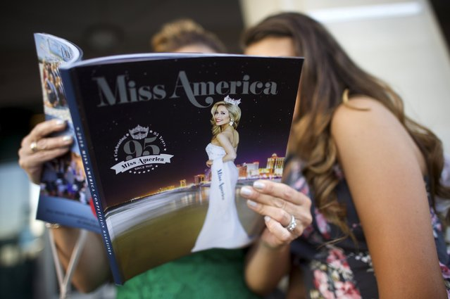 Attendees review a program in Boardwalk Hall, the venue for the 95th Miss America Pageant, that takes place tonight in Atlantic City, New Jersey, September 13, 2015. (Photo by Mark Makela/Reuters)